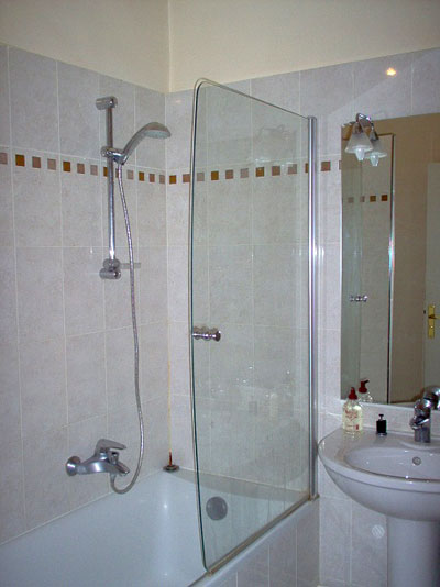 Paris apartment has a beautiful bathroom with a full shower, ample room to get ready, and a washing machine/dryer.