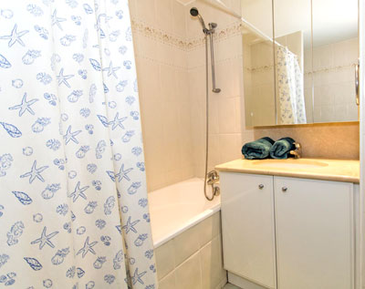 The master bedroom's private bathroom has a full bathtub and built in shower.