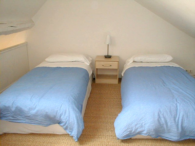 Paris apartment has two twin beds in the second bedroom