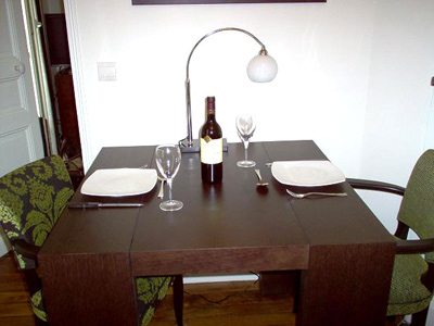 Paris apartment has a dining table for four; great Marais dinners.